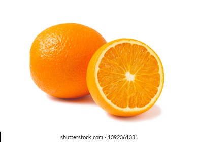 Fresh oranges, one whole and one half isolated on white background with shadow