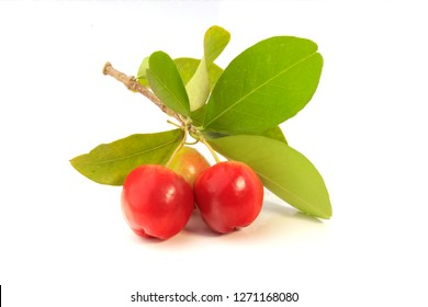 fresh organic acerola with green leaves, isolated on white background with clipping path. Antioxidant fruits