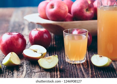 Fresh organic apple cider or apple juice on the old a wooden table.