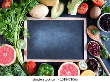 Fresh organic around a chalkboard with space
