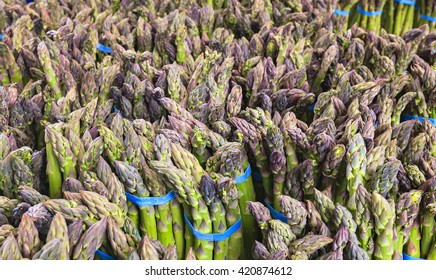 Fresh organic asparagus at a farmers market.