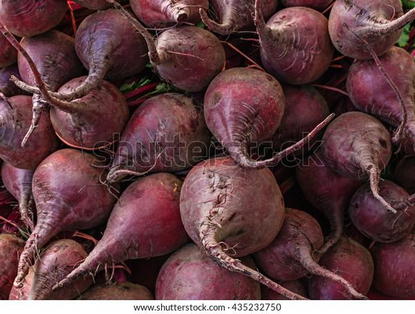 Fresh organic beets at a local farmers market.