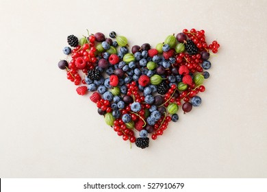 Fresh organic berries heart, healthy lifestyle