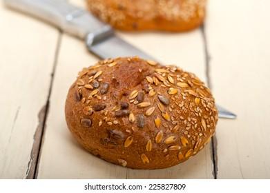 fresh organic bread over rustic table macro closeup