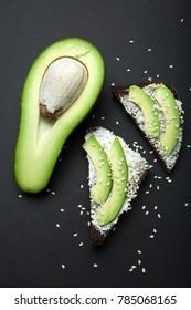 Fresh organic breakfast from avocado and black bread.