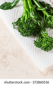 fresh organic broccolini saut�©ed and placed on a white paper towel