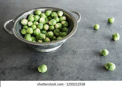 Fresh organic Brussels sprouts in metal colander