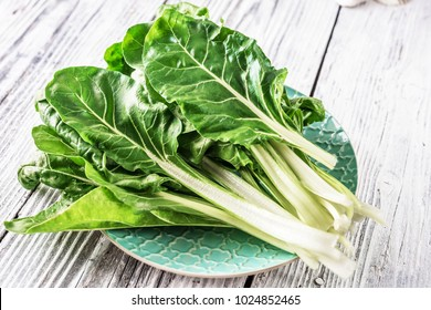 Fresh organic chard on a rustic background