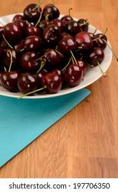 Fresh organic cherries on a plate