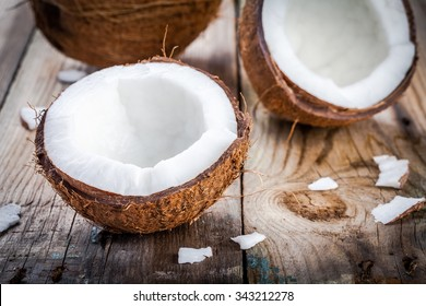 Fresh organic coconut on rustic wooden background