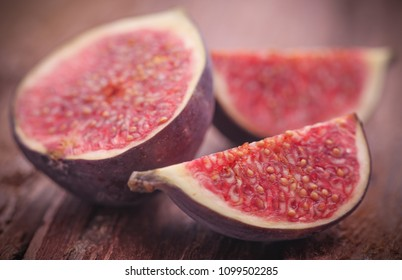 Fresh organic common fig on natural surface
