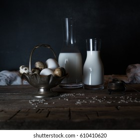Fresh organic eggs, milk and butter, still life in rustic style, vintage wooden background.