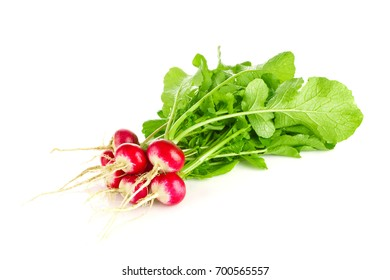 Fresh organic farm radishes with green leaves, isolated on white background.