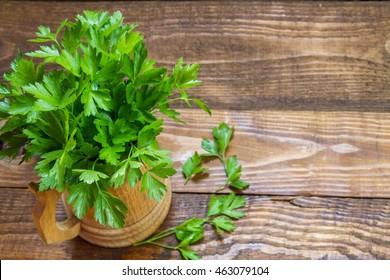 Fresh organic farmer parsley in a wooden bowl.