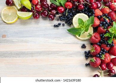 Fresh organic fruits isolated on rustic wooden table. with copy space for your design. Summer concept. Bright fruit frame on wooden background.