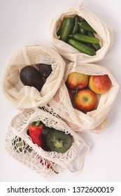 Fresh organic fruits and vegetables in cotton eco bags