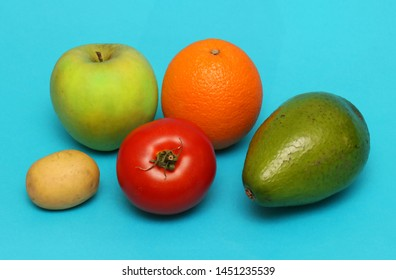 Fresh organic fruits and vegetables on blue background