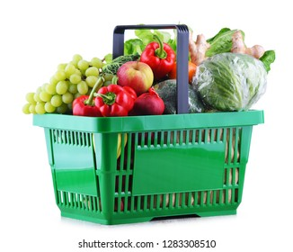 Fresh organic fruits and vegetables in plastic shopping basket isolated on white