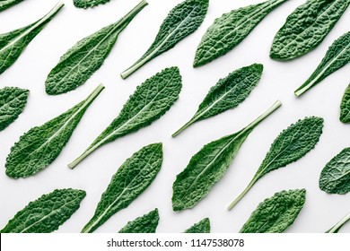 Fresh organic green kale leaves pattern on a white background, flat lay healthy nutrition concept