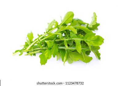 Fresh organic green rukkola, rucola or arugula, heap, salad leaves, isolated on white background