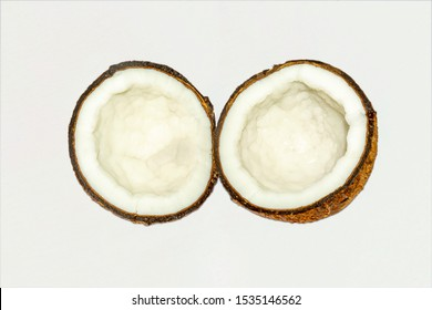Fresh, organic half coconut on white isolated background.close up and side angle view.