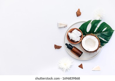 Fresh Organic healthy coconut butter with coconut pieces over white background