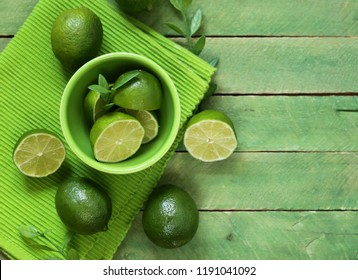 fresh organic lime on a wooden table