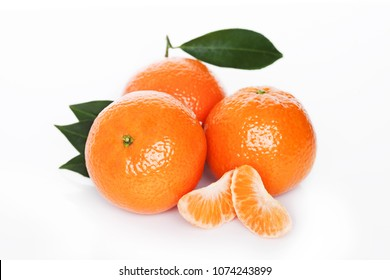 Fresh organic mandarins tangerines fruits with leaves on white background