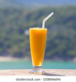 Fresh organic Mango shake in thai restaurant on the beach near sea in island Koh Phangan, Thailand. Close up