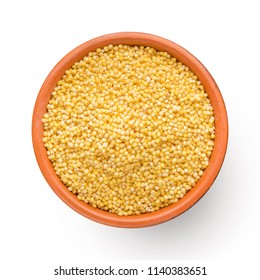 Fresh organic millet in clay bowl, top view, isolated on white background