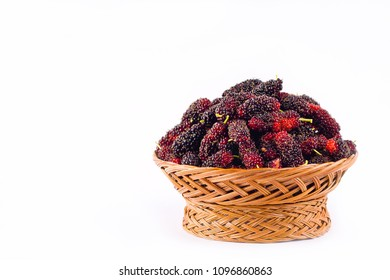 fresh organic mulberries in brown basket on white background healthy mulberry fruit food isolated