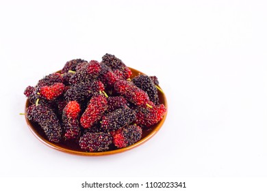 fresh organic mulberries in brown bowl on white background healthy mulberry fruit food isolated