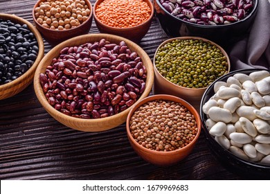 Fresh organic natural beans on wooden rustic background