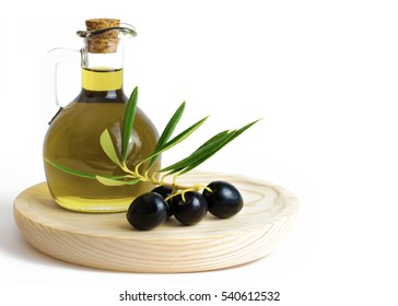 Fresh Organic Olive Oil  with olives on a wooden board isolated on a white background