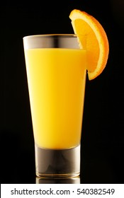 fresh organic orange juice  on a black background