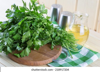Fresh organic parsley on wooden table. Selective focus.