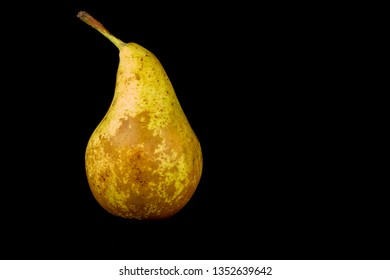 Fresh organic pear isolated against a black background