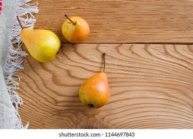 Fresh organic pears on old wood. Fruit background. Pear autumn harvest