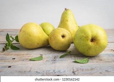 Fresh organic pears on old wood. Fruit background. Pear autumn harvest.
