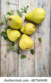 Fresh organic pears on old wood. Fruit background. Pear autumn harvest