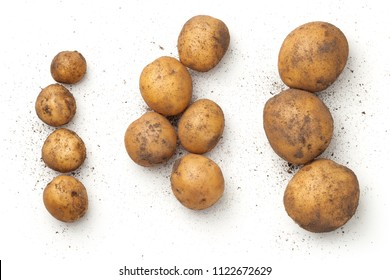 Fresh organic potatoes isolated on white background. Top view