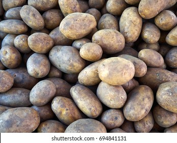 Fresh organic potatoes on display in a store market