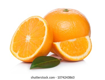 Fresh organic raw oranges with peeled halves with leaves on white background
