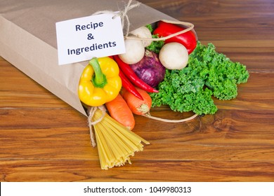 Fresh Organic Raw Vegetables food delivery in paper bag on wooden bench