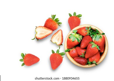 Fresh organic red berry strawberries in wooden bowl isolated on white background. Top view. Flat lay.