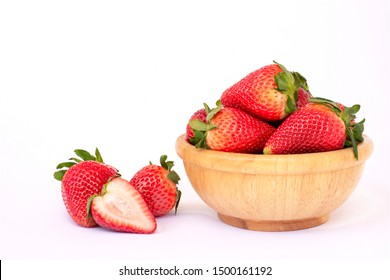 Fresh organic red berry strawberry  in wooden bowl isolated on white background.
