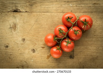 fresh organic red tomatoes on wooden table