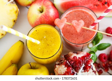Fresh organic red and yellow smoothie with apple, watermelon, pomegranate, raspberry, pineapple, banana and mango