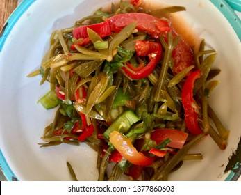 Fresh Organic Samphire Salad in Bowl / Crithmum maritimum.