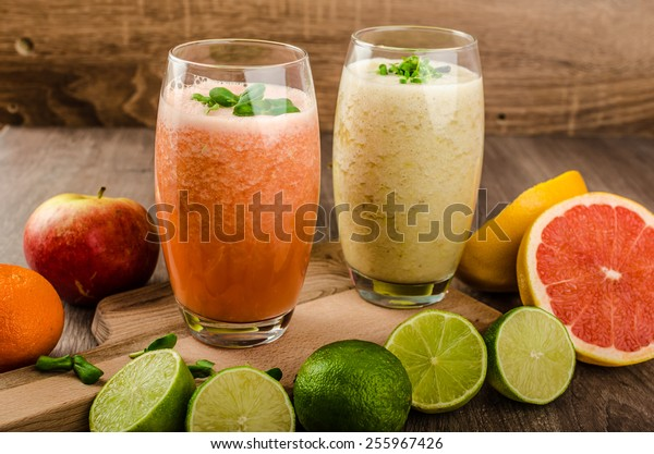 Fresh organic smoothie, lime with banana and grepfruit with green and red apple